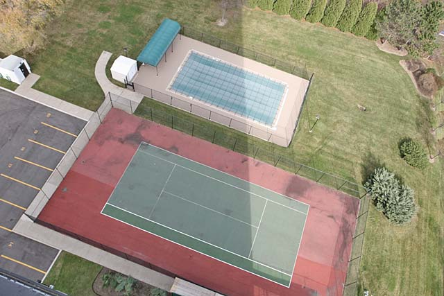 Outdoor pool and tennis court.